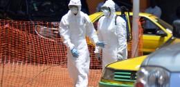140526-ebola-guinea-suits-1030a_be7522117c3410f0154d94668fcdfcb6