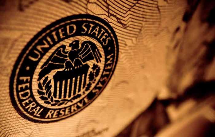 Guerra arancelaria afecta manufacturas y alza precios en EU: Fed