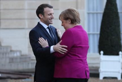 Merkel y Macron piden una globalización más justa en Davos