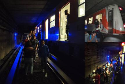 Usuarios caminan en vías por corto circuito en Línea 2 del Metro